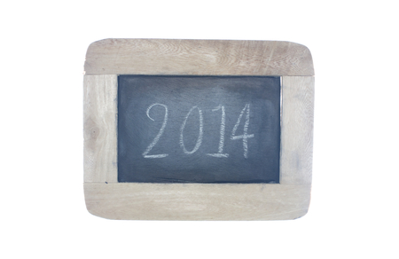 2014,written with chalk on blackboard,isolated on white  photo