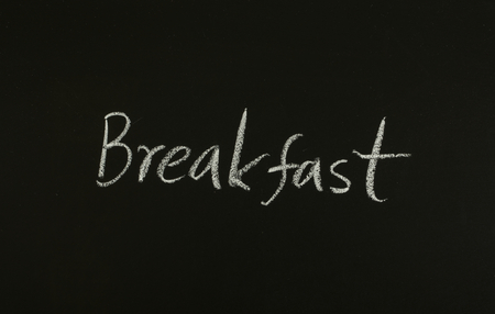 word breakfast written on blackboard