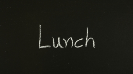 word lunch written on blackboard Stock Photo