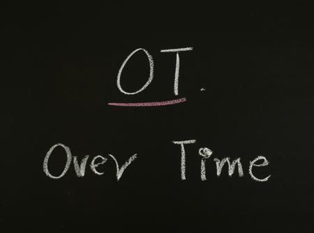 ot: word OT over time written on blackboard