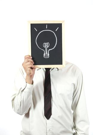 Businessman with a chalkboard light bulb photo
