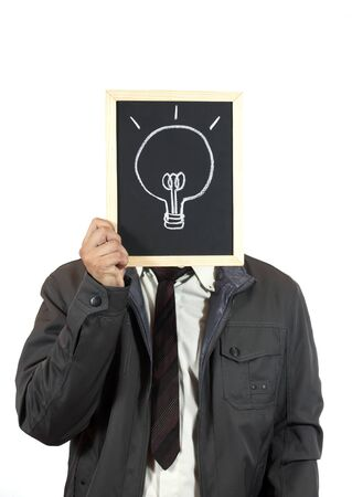 Businessman with a chalkboard light bulb