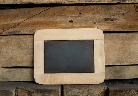 empty blackboard on wooden wall background photo