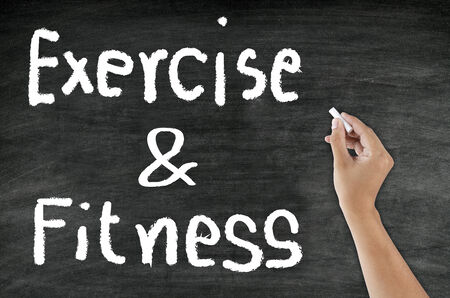 "mental activity: handwriting ""Exercise & Fitness"" with chalk on blackboard"