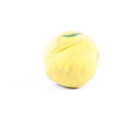 yellow modeling clay or plasticine on white background photo
