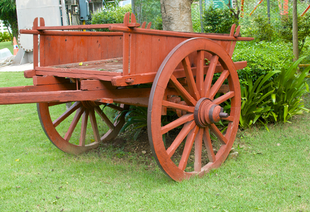 wooden cart in a park Stock Photo