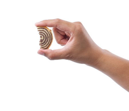 hand holding spiral cookie on white background photo