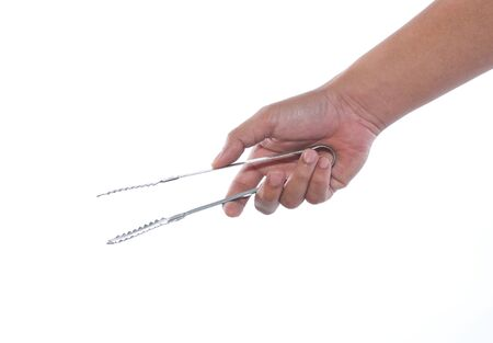 hand holding tongs on white background