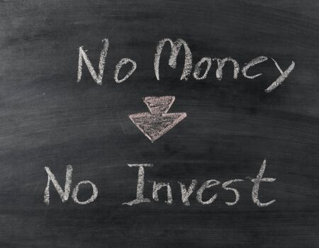 with no money: no money no invest text on blackboard