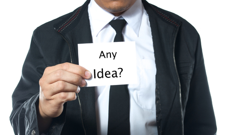 man holding card: business man holding card with word any idea