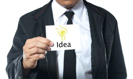 man holding card: business man holding card with word idea and light bulb