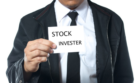 man holding card: business man holding card with word stock invester