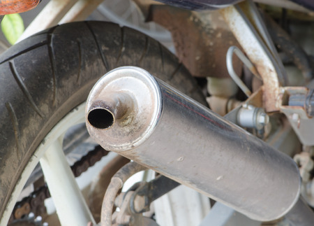 old exhaust tube of motorbike with oil stick Stock Photo