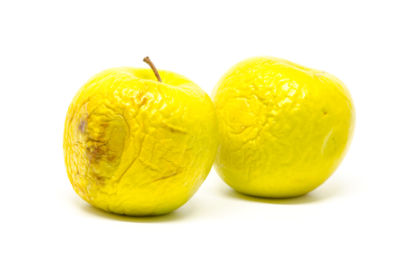 bad apple: rotten apple on white background Stock Photo