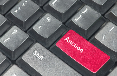 e auction: Auction button with black keyboard