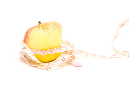 ate: ate apple and measure tape on white background
