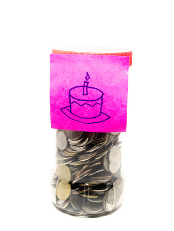 birth day: saving money bottle with thai coins and birth day,cake paper note Stock Photo