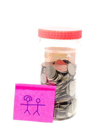 saving money bottle with thai coins and love paper note Stock Photo
