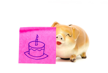 birth day: piggy bank with birth day,s cake drawing paper note