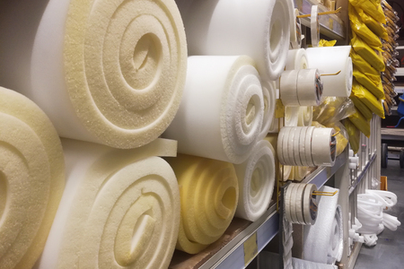 Rolls white and yellow foam rubber building material texture.