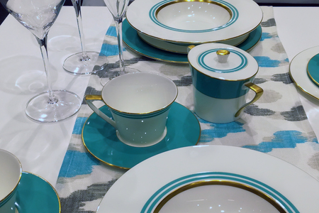 Empty elegant table set in white and blue colors modern style interior