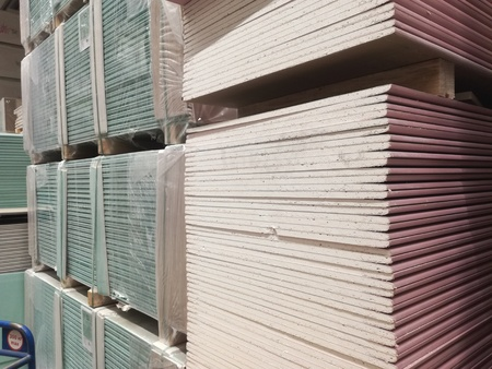 wooden bars at lumber yard of hardware store. Rack of pre-cut panel, mill wood timber, siding, plywood Stock Photo