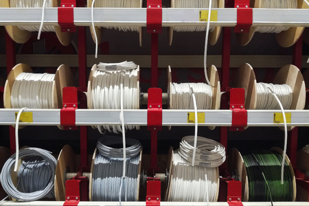 Different electric white cables. Electric wires cable products samples in store