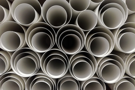 Warehouse of polypropylene plastic industrial pipes close up Stock Photo