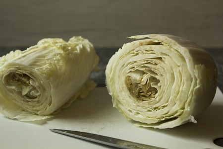 Half cutted rotten vegetable cabbage on a table. Unfresh food Zdjęcie Seryjne