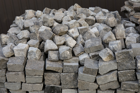 Stack of interlocking paving stones close up for installing driveway landscaping
