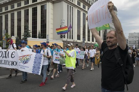 KyivUkraine - June 23, 2019: The annual Pride Parade LGBT. Man against gays with banner with inscription Sodomy is ugly