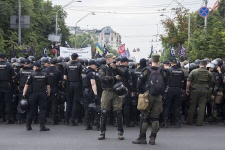 Kyiv Ukraine - June 23, 2019: battalion of police officers in body armors in the city Editorial