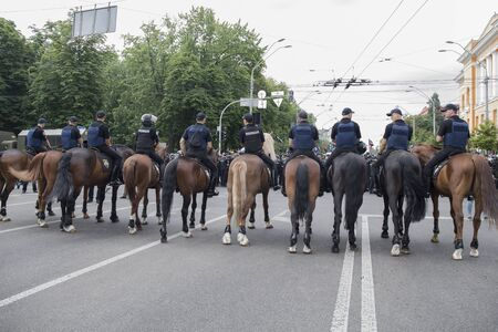 Kyiv, Ukraine - June 23, 2019. Mounted police on the road in the city