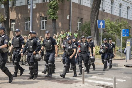 Kyiv Ukraine - June 23, 2019: battalion of police officers in body armors in the city 新聞圖片