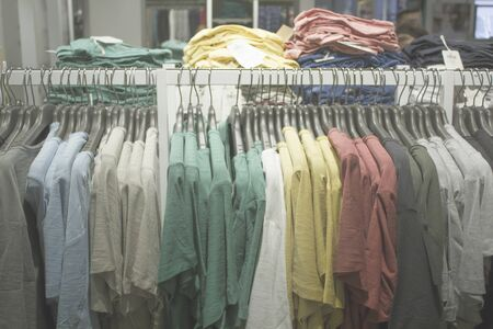 Blurred Bokeh Image of a garment with hanging apparel for background