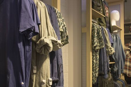 Man casual clothes hanging in the store. Season sale Stockfoto