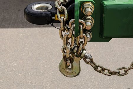 Transport anti-theft chain with padlock security lock close up on rear wheel, protection against theft