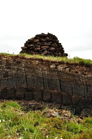 turba: vertical de la excavación de turba en Harris, Escocia Foto de archivo