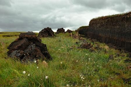 turba: Oblicua de la turba de excavación en Harris, Escocia