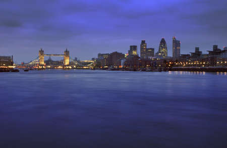 City of londonat dusk  with Thames river in foreground and tower bridge as subject photo