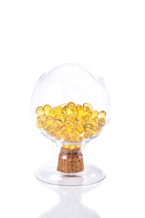 gels: Fish oil capsule, Omega 3-6-9 fish oil yellow soft gels capsules, Sacha inchi oil, Yellow oil pills in translucent bottle on white background