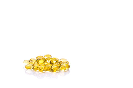 gels: Fish oil capsule, Omega 3-6-9 fish oil yellow soft gels capsules, Sacha inchi oil, Yellow oil pills on white background