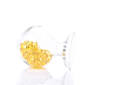 gels: Fish oil capsule, Omega 3-6-9 fish oil yellow soft gels capsules, Sacha inchi oil, Yellow oil pills in translucent bottle Stock Photo