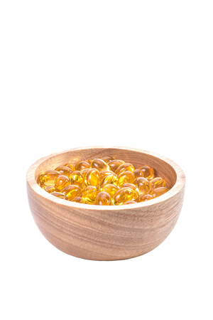 gels: Fish oil capsule, Omega 3-6-9 fish oil yellow soft gels capsules, Sacha inchi oil, Yellow oil pills in wood cup on white background