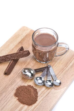 measuring spoon: cup of hot chocolate, measuring spoon, chocolate powder and chocolate bar Stock Photo