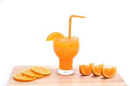 questioned: Orange juice smoothie and slices of orange