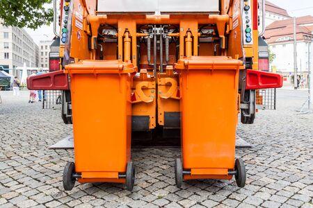 Orange rubbish truck