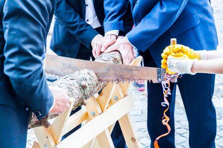 Cutting wood during wedding
