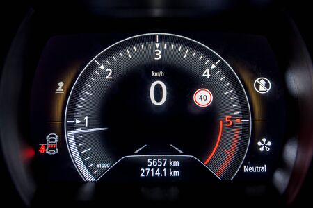 A speedometer of a car in the night