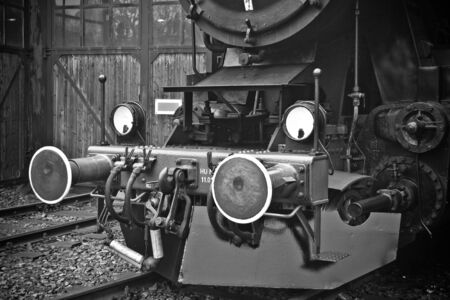 Old retro steam locomotive in a depot Фото со стока